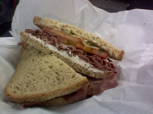 """The Piaf"" sandwich from Klein's Deli.  Features roast beef, cream cheese, horseradish, dill pickle, and tomatoes on light rye."