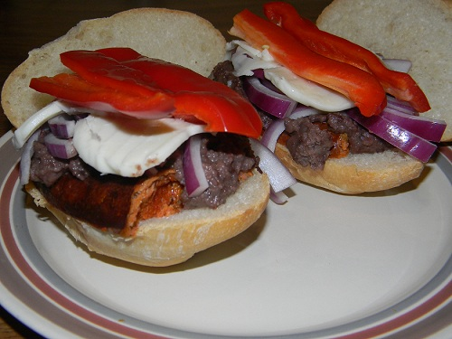 A chorizo and refried black beans sandwich, made at home.