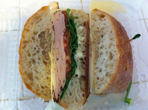 "Fresh-sliced honey roasted turkey and baby Swiss on ciabatta with lettuce, tomato, and ""Dijon"" mustard."