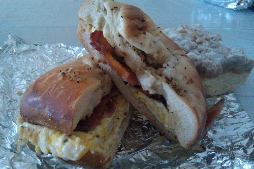 2 eggs and bacon on a bialy