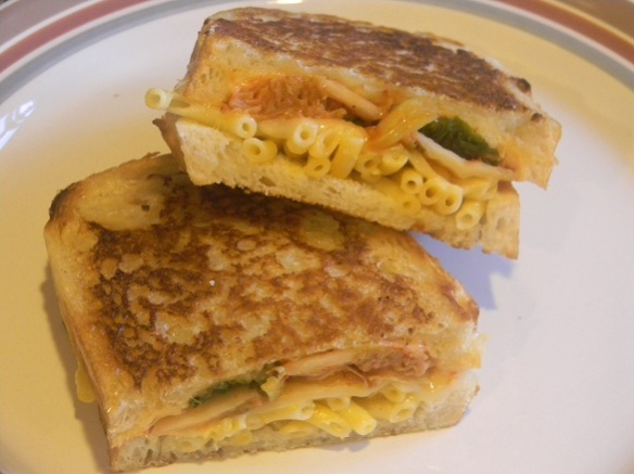 A grilled sandwich of kimchi, mac & cheese and other cheeses.